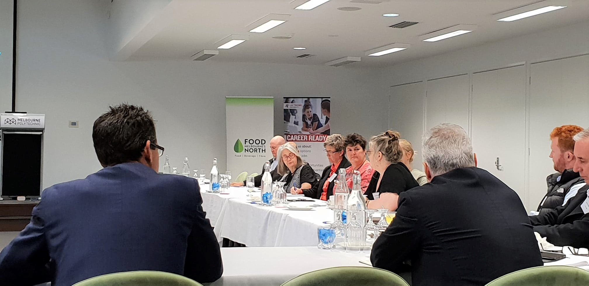 Passionate discussion between partners at Melbourne's North Food Group industry roundtable
